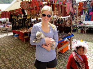 Holding a baby goat in the Pisac Market. Oh my gosh, baby goats- can i pleassee have like 5?
